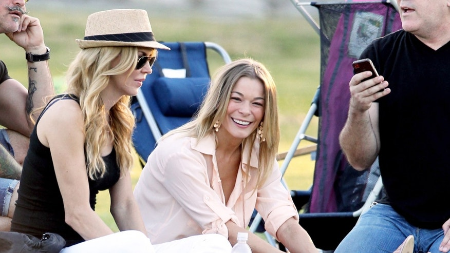 Brandi Glanville and LeAnn Rimes watch Glanville's son's soccer game.