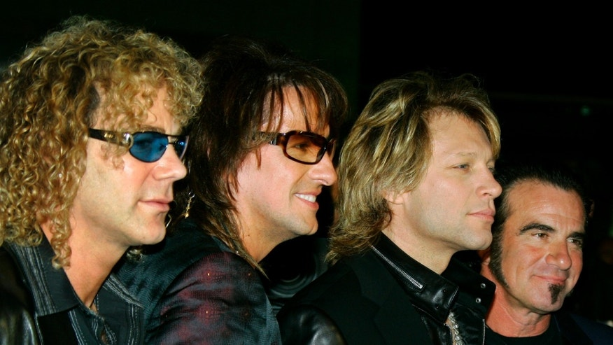 American singer Jon Bon Jovi  (2nd R) arrives with his band for Swarovski Fashion Rocks for The Prince's Trust in Monte Carlo October 17, 2005. The Prince's Trust aims to help young people overcome difficulties and get their lives back on track.