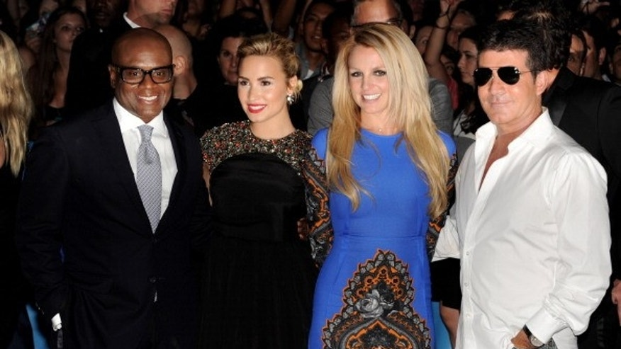 The X Factor judges (L-R) L.A. Reid, Demi Lovato, Britney Spears and Simon Cowell pose in Los Angeles, California.