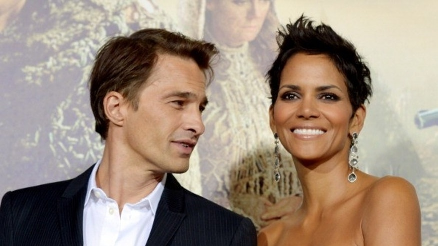 Actress Halle Berry (R) and actor Olivier Martinez (L) are facing controversy regarding a public brawl involving Berry's ex, Gabriel Aubrey.