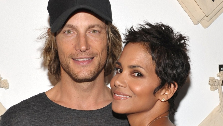 WEST HOLLYWOOD, CA - AUGUST 06:  Actress Halle Berry (R) and Gabriel Aubry attend the launch event for Gap's 1969 Jean Shop on Robertson Blvd at their 1969 Jean Shop on August 6, 2009 in West Hollywood, California.  (Photo by John Shearer/Getty Images for Gap)