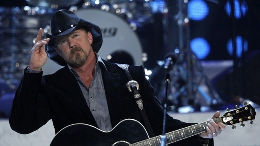 Country music star Trace Adkins performs during the 2010 Miss USA pageant at the Planet Hollywood Resort and Casino in Las Vegas, Nevada May 16, 2010. REUTERS/Steve Marcus (UNITED STATES - Tags: ENTERTAINMENT) FOR EDITORIAL USE ONLY. NOT FOR SALE FOR MARKETING OR ADVERTISING CAMPAIGNS