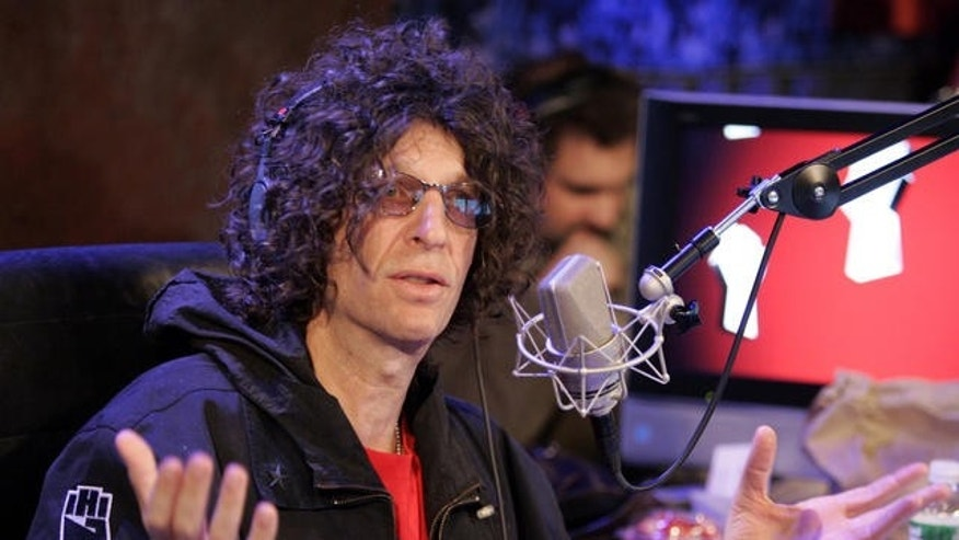 Radio personality Howard Stern responds to a question at an on-air news conference during his debut show on Sirius Satellite Radio, in New York, Monday Jan. 9, 2006. (AP Photo/Richard Drew)