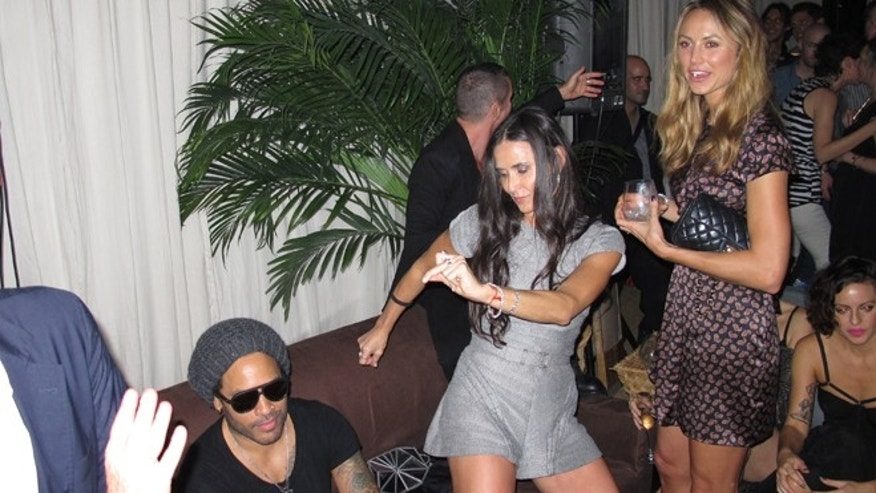 Demi Moore parties in Miami.