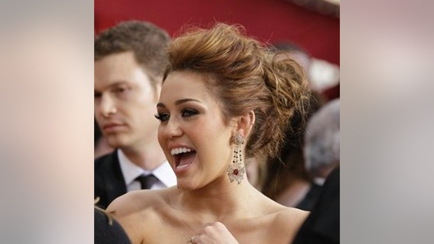 Actress and musician Miley Cyrus arrives at the 82nd Academy Awards Sunday, March 7, 2010, in the Hollywood section of Los Angeles. (AP Photo/Amy Sancetta)