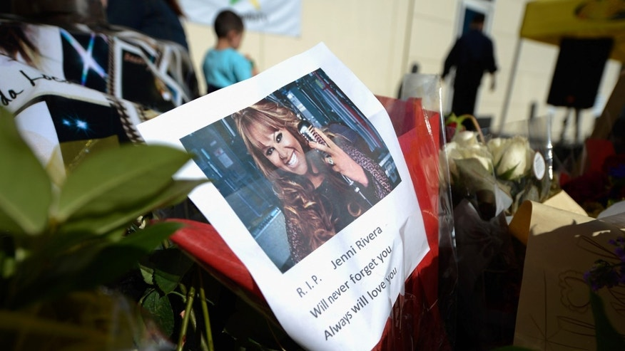 Dec. 10, 2012: Items are displayed at a makeshift memorial for Mexican-American singer Jenni Rivera at a Mexican radio station that is playing her songs continuously all day in Burbank, Calif.
