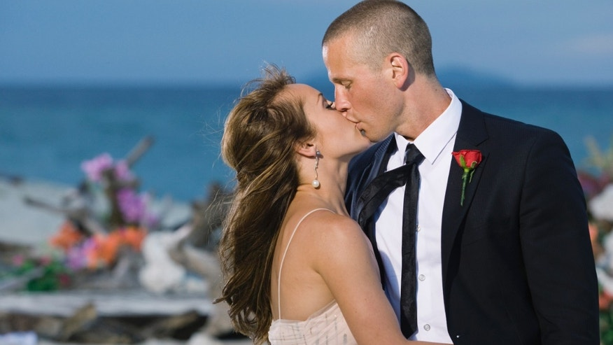 "Ashley Hebert, left, kisses J.P. Rosenbaum on the season finale of ""The Bachelorette"" in Fiji."