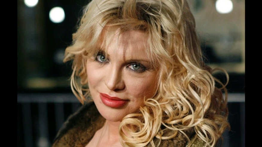 "Courtney Love arrives at the film premiere of 'Borat: Cultural Learnings of America for Make Benefit Glorious Nation of Kazakhstan"" in the Hollywood section of Los Angeles, Monday, Oct. 23, 2006. (AP Photo/Matt Sayles)"