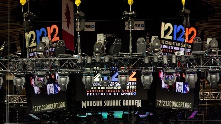 "Signage for the ""12-12-12"" concert is displayed on the Madison Square Garden jumbotron in New York."