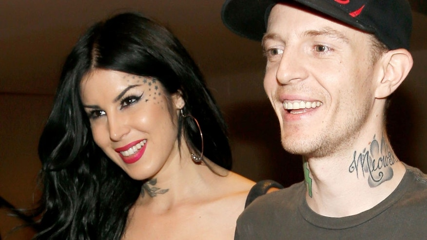 LAS VEGAS, NV - SEPTEMBER 22:  (L-R)  TV personality Kat Von D (L) and recording artist Joel Zimmerman aka Deadmau5 walk backstage during the 2012 iHeartRadio Music Festival at the MGM Grand Garden Arena on September 22, 2012 in Las Vegas, Nevada.  (Photo by Isaac Brekken/Getty Images for Clear Channel)