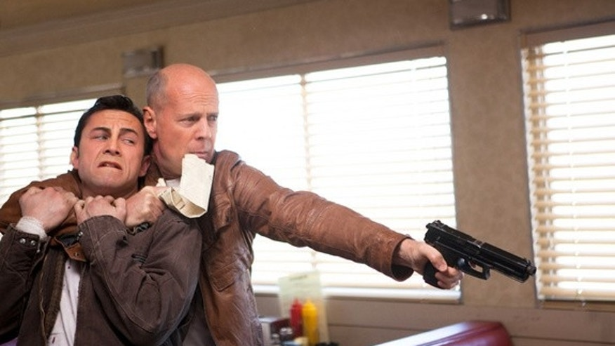 "Joseph Gordon-Levitt and Bruce Willis as ""Joe"" in TriStar Pictures, Film District, and End Game Entertainment's action thriller ""Looper."" Release date: September 28, 2012."