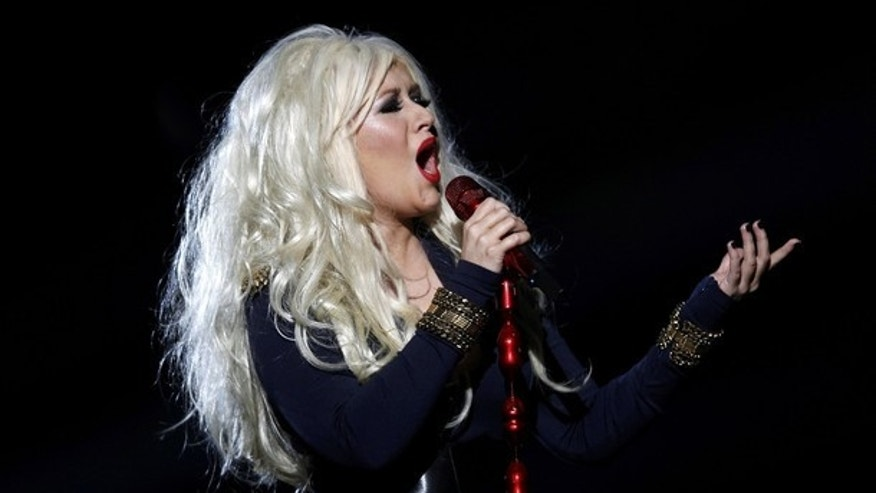 "Christina Aguilera performs during the ""Michael Forever"" tribute concert, which honours late pop icon Michael Jackson, at the Millennium Stadium in Cardiff, Wales October 8, 2011.      REUTERS/Eddie Keogh (BRITAIN  - Tags: ENTERTAINMENT)"