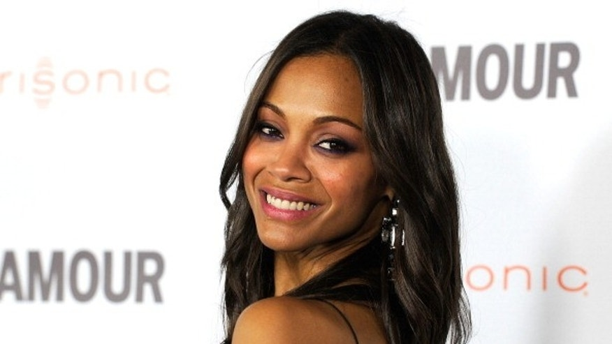 Actress Zoe Saldana arrives at Glamour Reel Moments held at the Directors Guild of America in Los Angeles, California.
