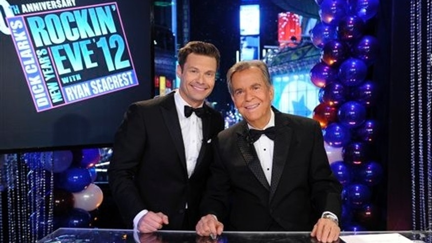 "In this Dec. 31, 2011 photo released by ABC, hosts Dick Clark, right, and Ryan Seacrest pose on the set of ""Dick Clark's New Year's Rockin' Eve with Ryan Seacrest 2012"" in Times Square in New York.  (AP Photo/ABC, Ida Mae Astute)"
