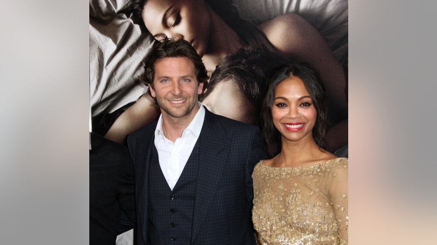 "Actor Bradley Cooper (L) and actress Zoe Saldana attend the premiere of ""The Words"" at the ArcLight Cinemas in Hollywood, California."