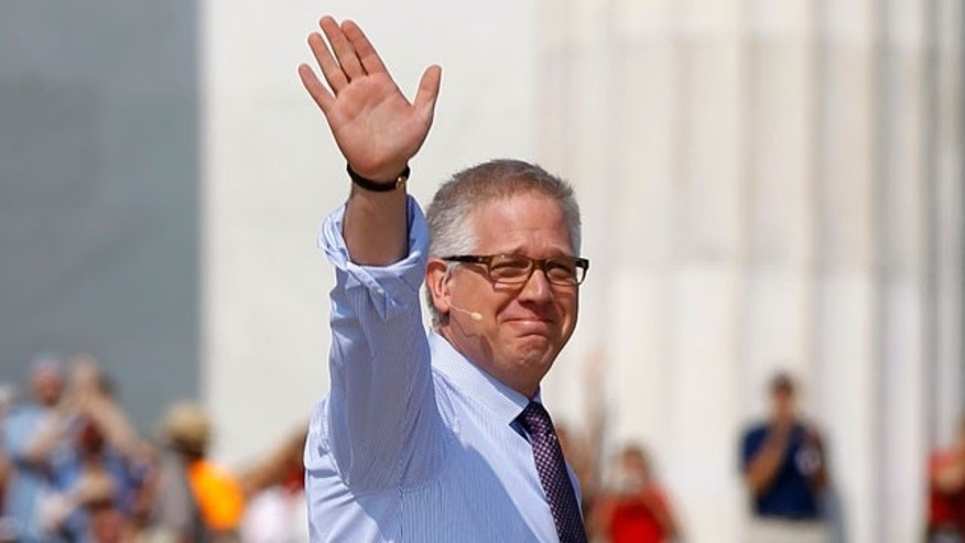 Glenn Beck waves as he arrives to speak at his 'Restoring Honor' rally in front of the Lincoln Memorial in Washington, Saturday, Aug. 28, 2010.
