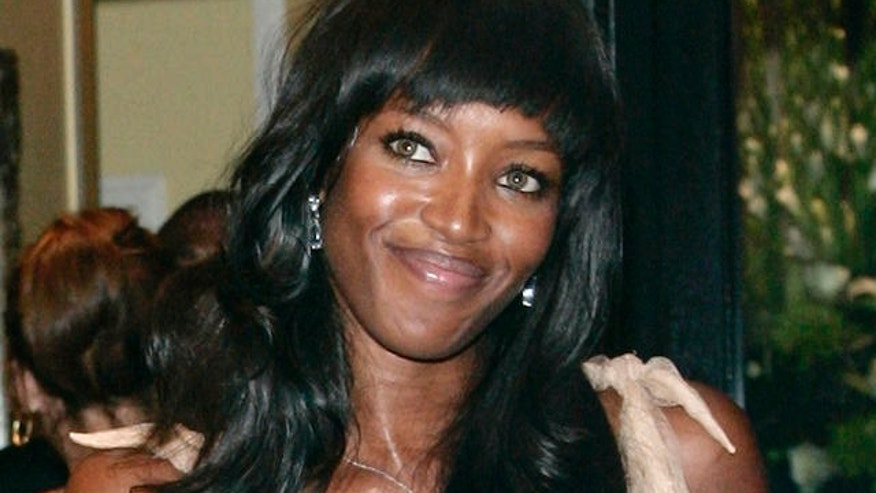 British supermodel Naomi Campbell arrives at the Black Leaders' Dinner in London held in honour of Nelson Mandela, former President of South Africa, Tuesday, Aug. 28, 2007. Mandela is in Britain for the unveiling of his statue, Wednesday in Parliament Square. (AP Photo/Sang Tan)