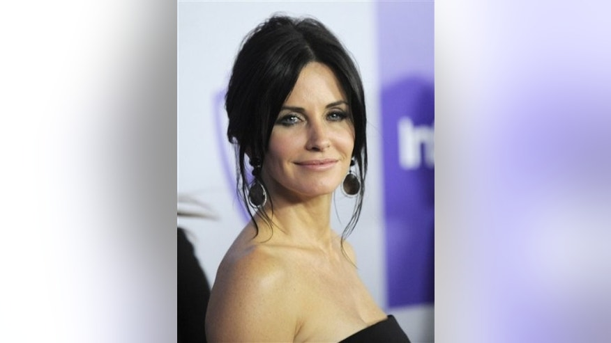 Courteney Cox arrives to the InStyle/Warner Bros. party following the 67th Annual Golden Globe Awards on Sunday, Jan. 17, 2010, in Beverly Hills, Calif. (AP Photo/Chris Pizzello)