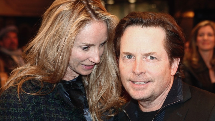 Michael J. Fox and wife Tracey Pollan at a Bruce Springstein concert in 2012.