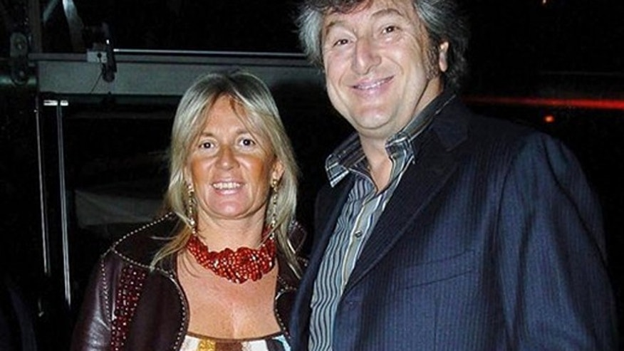 Vittorio Missoni, right, and his wife Maurizia Castiglioni smile in Milan, Italy on March 30, 2005.