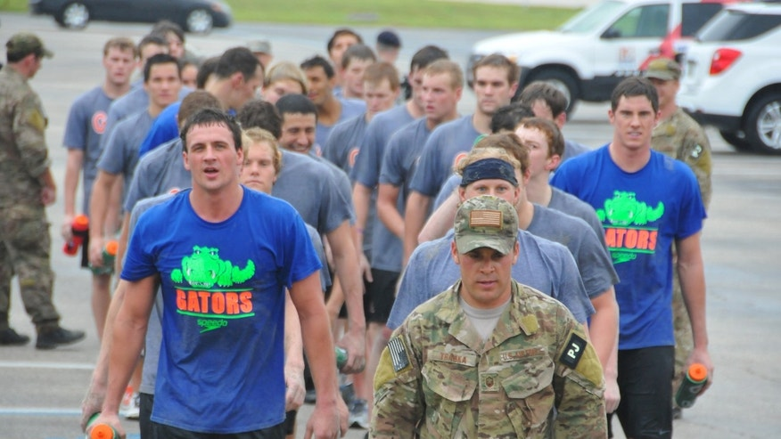 Jan. 4, 2012: Olympic gold medalists Ryan Lochte, front left, and Conor Dwyer, wearing a Gators t-shirt at far right, and members of the University of Florida swim team workout with members of the Guardian Angels of the 920th Rescue Wing at Patrick Air Force Base, Fla.