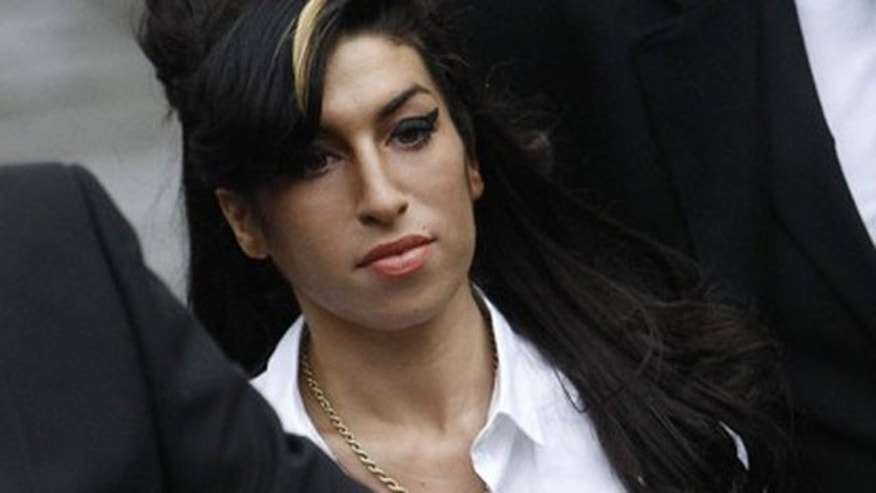 Jan. 20: British singer Amy Winehouse arrives at Milton Keynes Magistrates' Court, southern England.