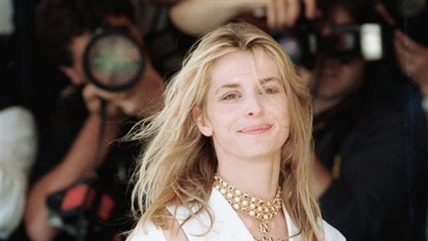 In this May 18, 1993 file photo, German actress Nastassja Kinski poses at the 46th International Cannes Film Festival in Cannes, France.