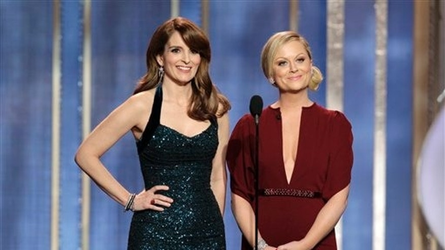 Co-host Tina Fey, left, and Amy Poehler on stage during the 70th Annual Golden Globe Awards on Jan. 13, 2013.