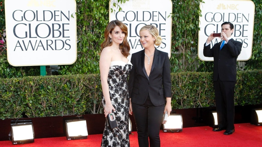 Golden Globe co-hosts, actresses Tina Fey and Amy Poehler, arrive at the 70th annual Golden Globe Awards in Beverly Hills.