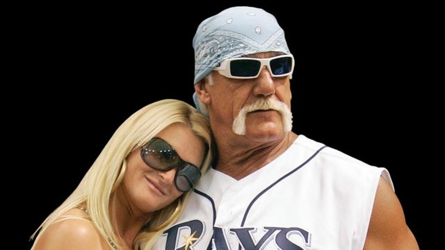 Wrestler Hulk Hogan, right, and his girlfriend, Jennifer McDaniel, watch the New York Yankees take batting practice before a baseball game against the Tampa Bay Rays on Wednesday, Sept. 3, 2008, in St. Petersburg, Fla. (AP Photo/Chris O'Meara)