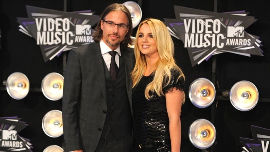 Aug. 28, 2011: In this file photo, Jason Trawick and Britney Spears arrive at the MTV Video Music Awards in Los Angeles.