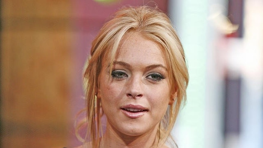 "Actress Lindsay Lohan appears on stage during a taping of MTV's ""Total Request Live"" at the MTV Times Square Studios, Tuesday, May 8, 2007 in New York. The show airs Thursday, May 10. (AP Photo/Jeff Christensen)"