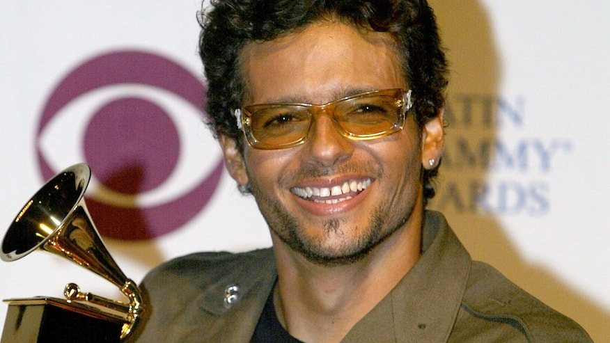 "LOS ANGELES - SEPTEMBER 1:  Musician Robi Draco Rosa winner of Best Music Video for ""Mas Y Mas"" poses backstage at the ""5th Annual Latin Grammy Awards"" held at the Shrine Auditorium on September 1, 2004 in Los Angeles, California.  (Photo by Mark Mainz/Getty Images)"