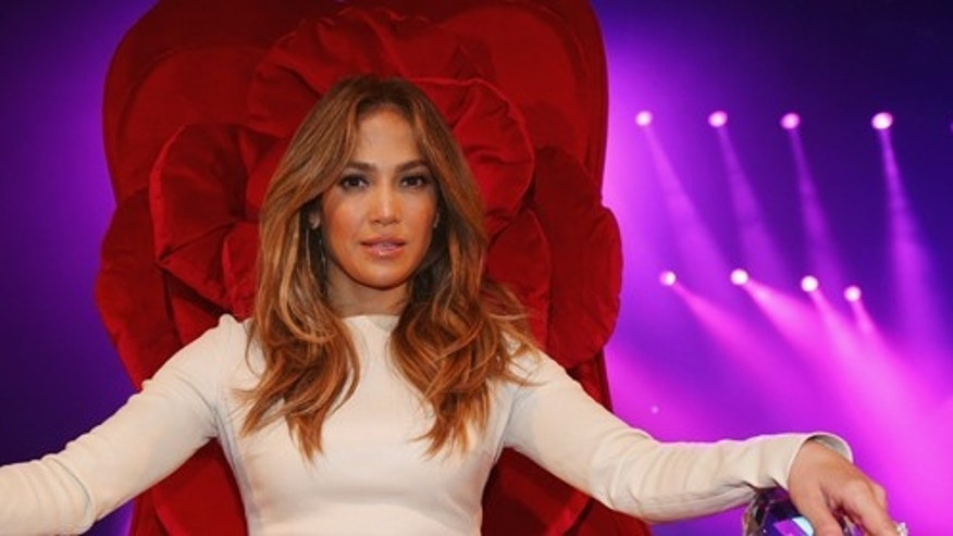 MELBOURNE, AUSTRALIA - DECEMBER 11:  Jennifer Lopez poses at a press call at Rod Laver Arena on December 11, 2012 in Melbourne, Australia.  (Photo by Scott Barbour/Getty Images)