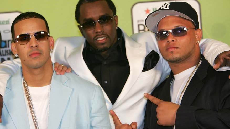 "MIAMI - APRIL 28:  Rapper Daddy Yankee (L) and Sean ""P Diddy"" Combs (C) pose backstage at 2005 Billboard Latin Music Awards at the Miami Arena April 28, 2005 in Miami, Florida.  (Photo by Paul Hawthorne/Getty Images)"