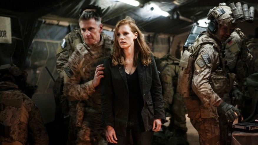 "In this undated publicity photo released by Columbia Pictures Industries, Inc., Jessica Chastain, center, plays a member of the elite team of spies and military operatives, stationed in a covert base overseas, with Christopher Stanley, left, and Alex Corbet Burcher, right, who secretly devote themselves to finding Usama Bin Laden in Columbia Pictures' new thriller, ""Zero Dark Thirty."""