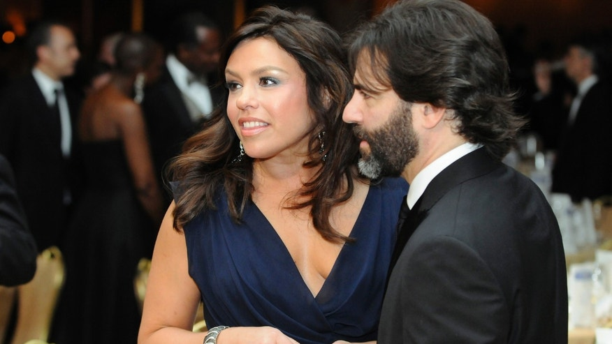 TV food personality Rachael Ray and her husband John Cusimano attend the White House Correspondents' Association Dinner in Washington, May 1, 2010.