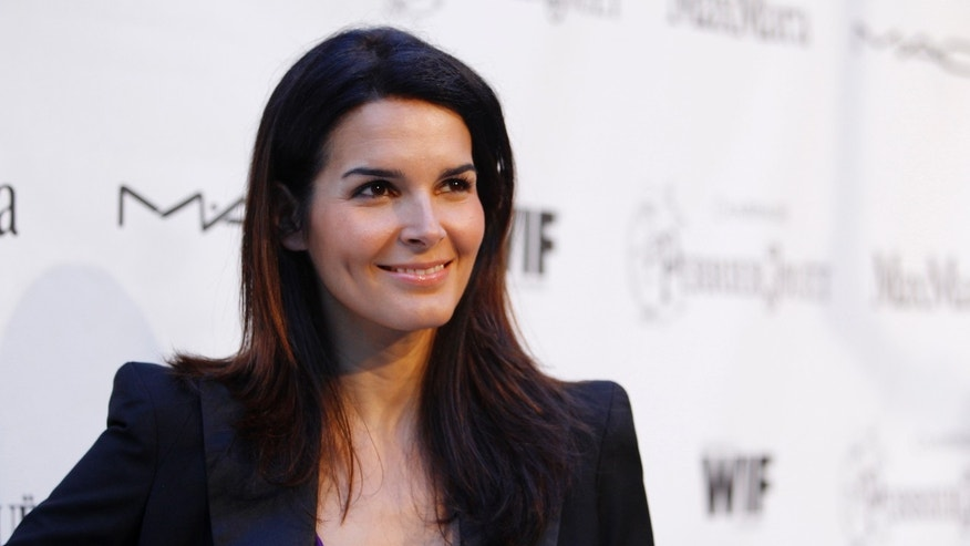 Actress Angie Harmon poses at the 3rd annual Women In Film, LA Pre-Oscar party in Los Angeles March 4, 2010.