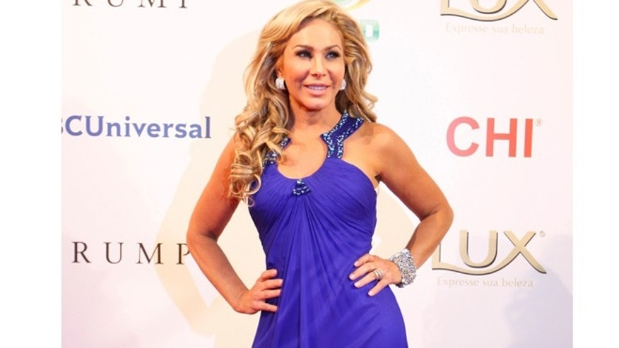 U.S. television personality and businesswoman Adrienne Maloof poses on the red carpet as she arrives as one of the judges for the Miss Universe 2011 pageant in Sao Paulo.