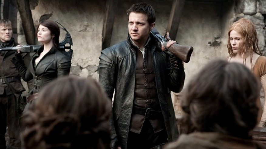 "This film image released by Paramount Pictures shows Gemma Arterton as Gretel, from left, Jeremy Renner as Hansel and Pihla Viitala as Mina, in a scene from ""Hansel & Gretel: Witch Hunters."""