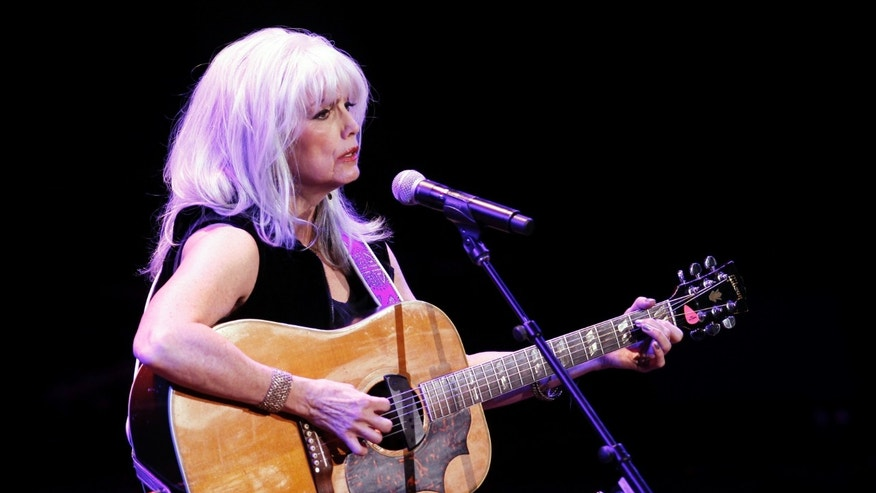 Singer Emmylou Harris performs during the 'A Celebration of Paul Newman's Hole in the Wall Camps' fundraising concert in New York October 21, 2010.