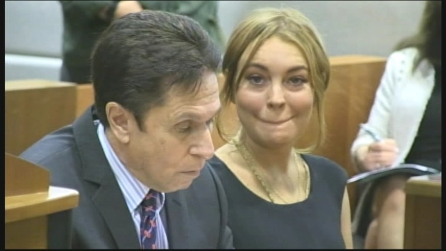 Lindsay Lohan and attorney Mark Heller in court on Jan. 30, 2013.