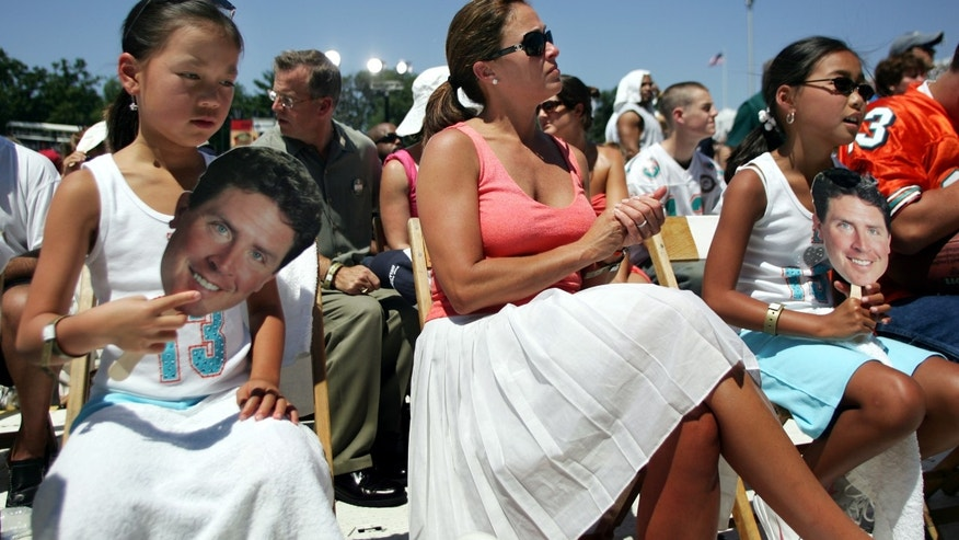 Dan Marino's wife and two adopted daughters attend his Hall of Fame induction ceremony in 2005.