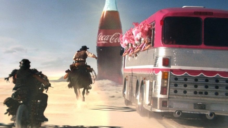 This frame grab provided by Coca Cola, shows a moment in the Super Bowl 2013 Coca Cola campaign.