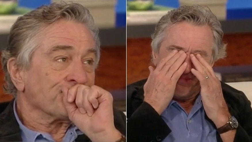 Robert De Niro tears up during an interview with Katie Couric.