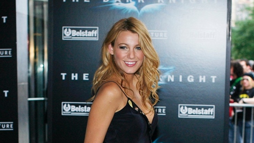 Actress Blake Lively poses for photographers as she arrives for the premiere of the film The Dark Knight in New York, July 14, 2008. REUTERS/Keith Bedford (UNITED STATES)