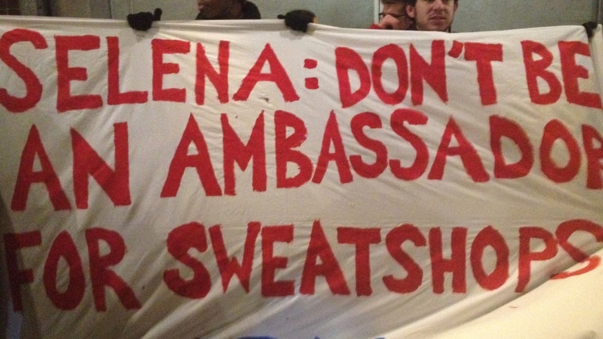 Protesters from the United Students Against Sweatshops at the Fashion Show for the Adidas' Neo label.
