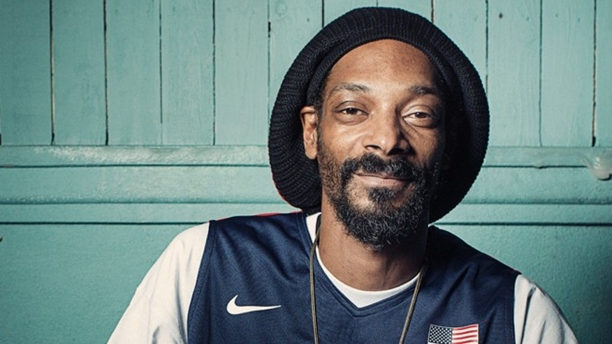 July 30, 2012: This photo shows Snoop Dogg posing for a portrait at Miss Lily's in New York.