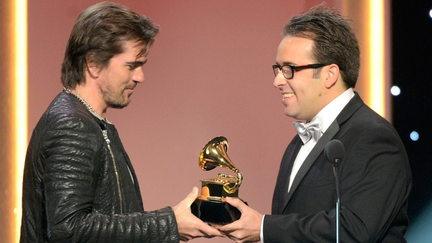 Feb.10, 2013:  Juanes (L), winner of best Latin pop album, onstage at the The 55th Annual GRAMMY Awards at Staples Center  in Los Angeles, Calif.