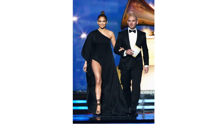 LOS ANGELES, CA - FEBRUARY 10:  Singers Jennifer Lopez and Pitbull speak onstage at the 55th Annual GRAMMY Awards at Staples Center on February 10, 2013 in Los Angeles, California.  (Photo by Kevork Djansezian/Getty Images)